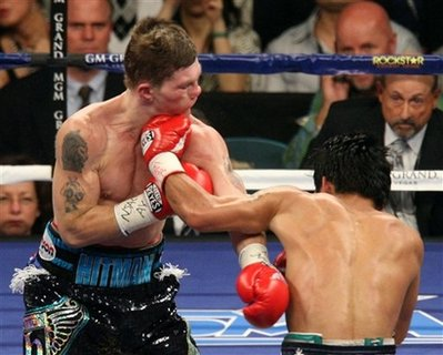 Manny Pacquia, right of the Philippines, delivers the final knockdown punch to British boxer Ricky Hatton during the dying seconds of the second roundof their junior welterweight boxing match May 2, 2009 in Las Vegas