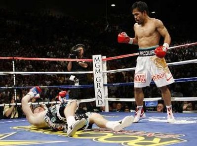 Ricky Hatton of Britain (left) goes down in a TKO in the second round during his fight with Manny Pacquia o of the Philippines in their 12 round super lightweight world championship bout